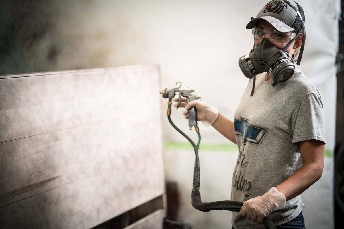 Photo of worker finishing wood
